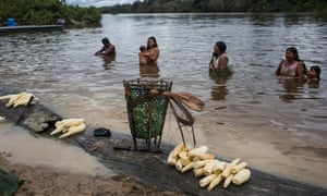 Poti-Kro, Para, Brazil: Much daily activity happens at the riverside. Here, Xikrin women combine washing harvested yucca with bathing.