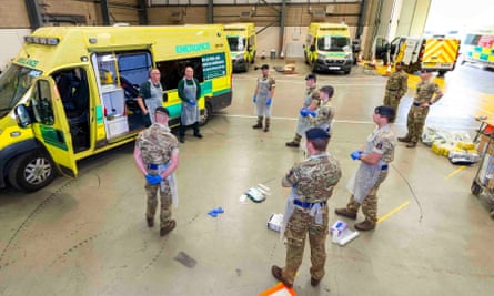 NHS paramedics training soldiers on the use of ambulances and PPE at the Wattisham Flying Station in Suffolk, 17 April 2020