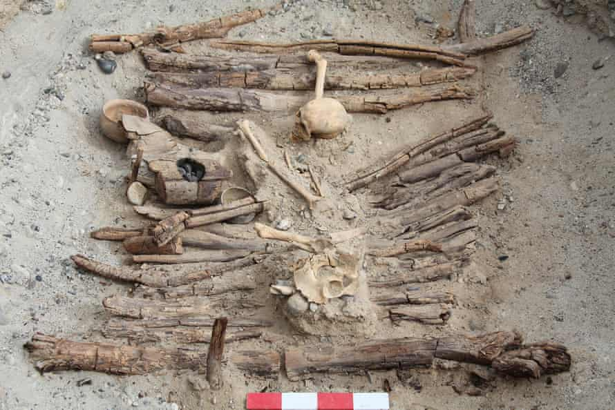 A photo of a brazier and skeleton found in one of the tombs during excavations.