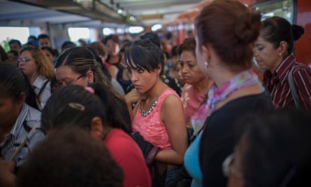 A crowd of commuters moves toward a staircase after exiting the subway at the Pantitlan Metro station in Mexico City. The Mexican capital has the second-largest metro system in North America after New York.