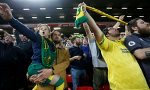 Norwich City fans celebrate after their first goal scored by Teemu Pukki
