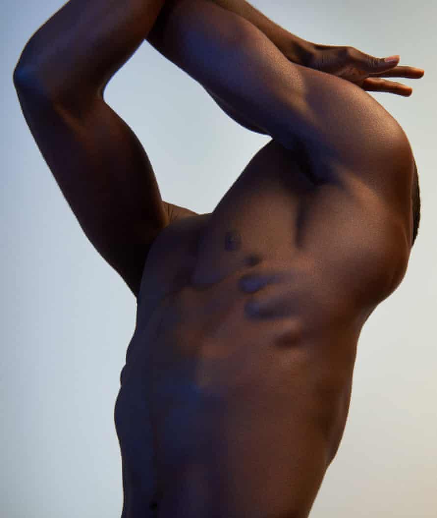 A muscular black man's torso
