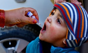 A child in Quetta, Pakistan, receives a polio vaccination