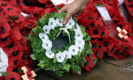 A white poppy wreath is placed next to red poppies at Bradford cenotaph during a Peace Pledge Union gathering, 13 November 2016.