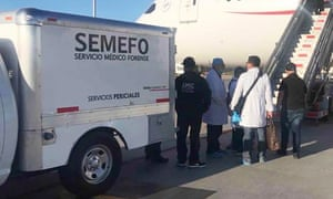Mexican forensic workers meet the Aeromexico plane forced to land after a Japanese man who swallowed 246 packs of cocaine died on a flight from Bogota to Tokyo.