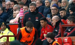 Manchester United's Alexis Sanchez (third right) sits in the seat of interim manager Ole Gunnar Solskjaer before being moved.