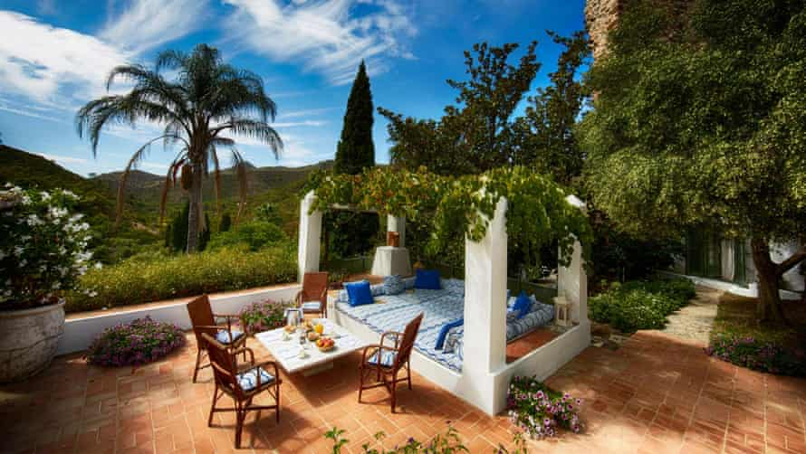 The property offers shaded terraces, daybeds and alfresco dining