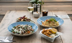 The Quince Tree Cafe dishes: calamari, crab and prawn linguini, chicken skewers and pulled lamb shoulder salad with green beans.
