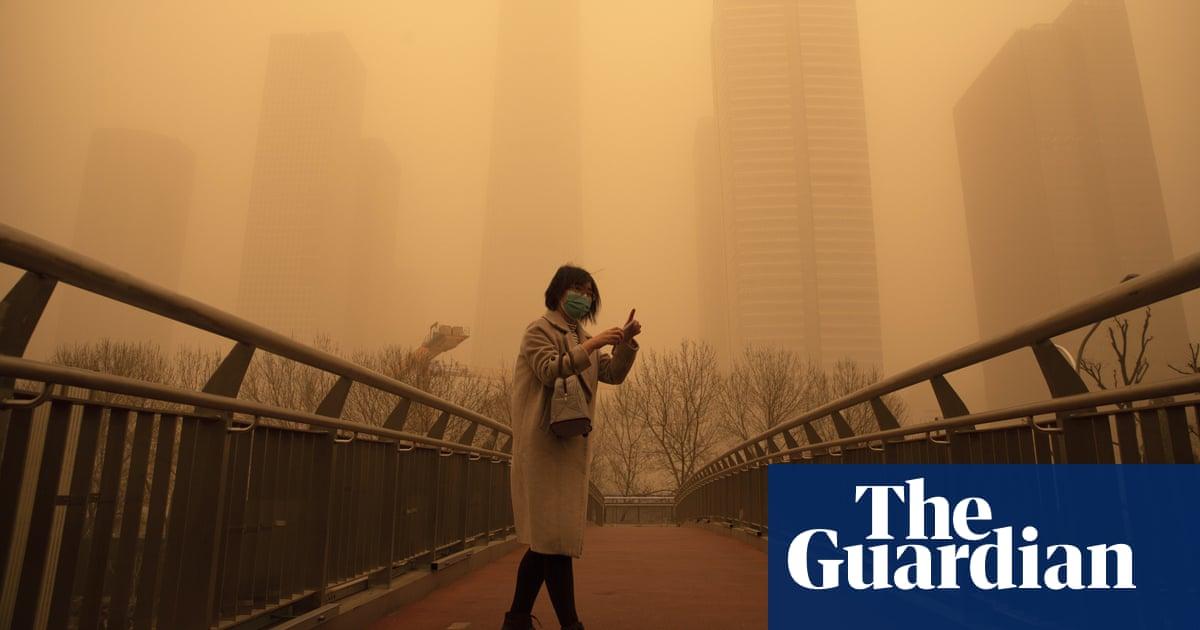 Beijing skies turn orange as sandstorm and pollution send readings off the scale