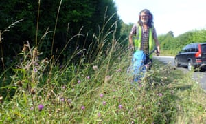 A roadside nature reserve being cut in Flordon, Norfolk