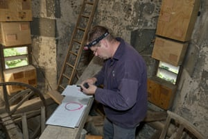 Simon Evans ringing a common swift chick removed briefly from a nest box in All Saints Church belfry in Worlington, Suffolk. Swift groups have installed multiple nest boxes in several old churches across the UK with great success. A 2017 project to install a swift call playback system in a medieval bell tower in Bradford on Avon attracted swifts within days to inspect a multiple nest box. The hope is they will nest there this year.