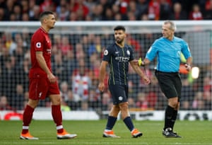 Aguero is shown a yellow card by referee Martin Atkinson.