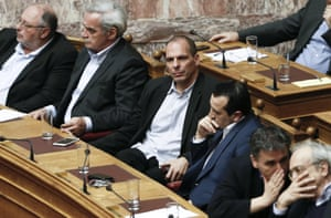 Greek Finance Minister Yanis Varoufakis, third left, listens the speech of Greek Premier during a parliamentary session, in Athens, on Monday, March 30, 2015, after Greece's Prime Minister Alexis Tsipras called the special session of parliament to brief lawmakers on the course of recent troubled negotiations with bailout lenders to overhaul cost-cutting reforms. Greece is under pressure to convince creditors it has viable alternatives to the reforms, with government cash reserves running low. (AP Photo/Petros Giannakouris)