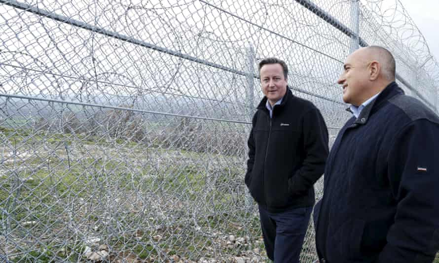 David Cameron and the Bulgarian prime minister, Boyko Borissov, during their visit to the fence constructed along the Bulgarian-Turkish border in Lesovo.