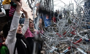 Syrian refugees flocked to the border with Greece after Turkey said it would open border gates to allow migrants to cross into Europe.