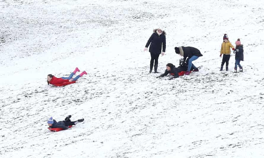 People sledging in the snow in Bradford on 2 January.