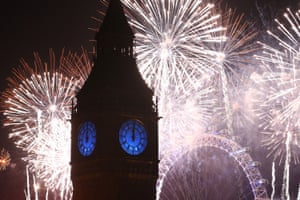 Fireworks light up Big Ben just after midnight