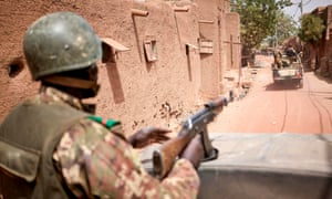 Troops of the Malian army patrol the town of Djenne in February.