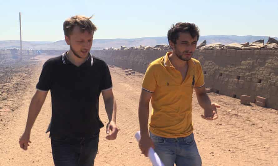 Alexey Nikitin (left) and Zakir Ismailov at a brick factory in Dagestan