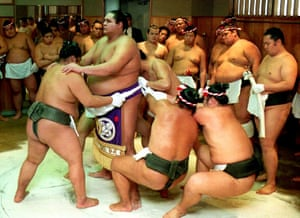 Two years later a foreigner US sumo wrestler Akebono was elevated to yokozuna (grand champion) status. Akebono, real name is Chad Rowan and from Hawaii, is pictured second left, getting help from his colleagues in January 1993 in putting on a ceremonial apron in preparation for a traditional ceremony marking his Yokozuna promotion