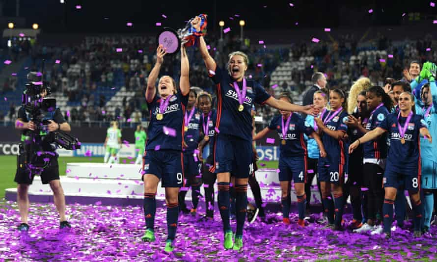 Eugénie Le Sommer (left) and Ada Hegerberg of Lyon celebrate with the Uefa Women's Champions League trophy after beating Wolfsburg in Kiev in May.