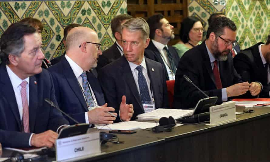 Chile's foreign minister Roberto Ampuero, Canada's parlimentary secretary Andrew Leslie and Brazil's foreign minister Ernesto Araujo attend a meeting of the Lima Group in Lima, Peru on 4 January.