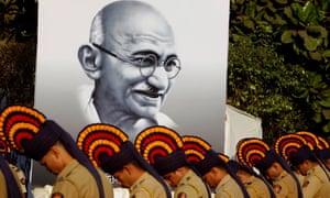 Police personnel pay homage to Mahatma Gandhi near Mumbai