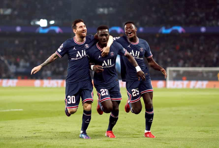 Idrissa Gueye (centre) celebrates his early goal with Lionel Messi and Nuno Mendes.