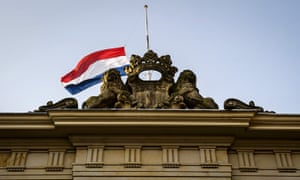 The Dutch flag flies at half-mast above the Ministry of Defence in The Hague in commemoration of the victims of MH17.
