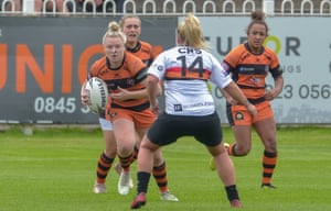 Castleford Tigers' Georgia Roche surges forward against Bradford Bulls. Castleford are top of the Women's Super League with six wins from their six games this season.