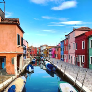 Multicoloured fisherman's houses either side of a canal on the island of Burano, in the Venice lagoon, Italy.