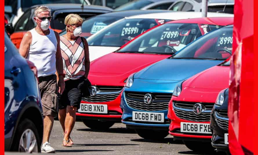 Would-be buyers pictured at Vauxhall Lookers in Speke, Liverpool, after car showrooms reopened for the first time since lockdown.