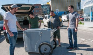 UBC grad students Kurt Yesilcimen, second from left, and Connor Keegan, far right, give the cart a final inspection before handing it over to Metro Community Church's Devon Siebenga and Ramsay Collier.