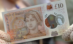 """""""Bank Of England Unveils Jane Austen Ten Pound Note<br>WINCHESTER, UNITED KINGDOM - JULY 18:  People in period costume pose with one of the Bank of England's new ten pound notes, featuring British author Jane Austen, during its unveiling at Winchester Cathedral on July 18, 2017 in Winchester, England. Two hundred years after Jane Austen's death, Britain is celebrating one of its best-loved authors, who combined romance with biting social commentary that still speaks to fans around the world. Austen is buried in the cathedral in Winchester, where she died.  (Photo by Chris J Ratcliffe-Pool/Getty Images)"""""""