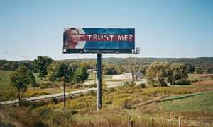 An anti-Hillary Clinton billboard spotted from her husband's campaign bus, as former President Bill Clinton travels through Ohio as part of a 48 hour, three-city bus tour