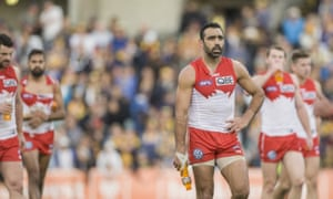Adam Goodes leads the Swans from the field after their defeat to the West Coast Eagles that will be remembered for all the wrong reasons.