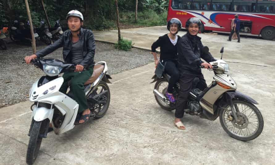 Hieu, Luan and Liz on motorbikes.