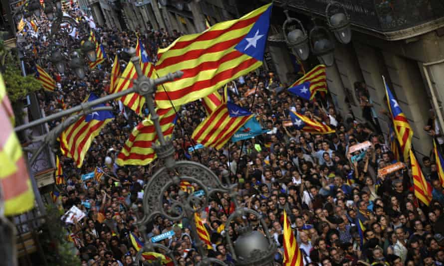 Pro-independence supporters flood streets near the Palau Generalitat in Barcelona.