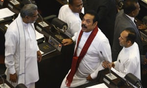 Mahinda Rajapaksa (centre right), Sri Lanka's former president and newly appointed prime minister, leaving parliament in Colombo amid violent protests.