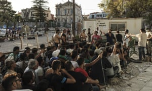 Syrian migrants wait to register with authorities on the isle of Lesbos. An aid charity says the island is overwhelmed by the number of people arriving.
