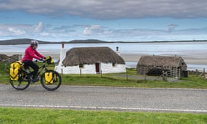 Traditional Hebridean White House and cyclist