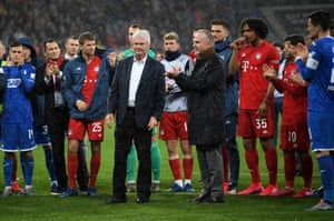 Karl-Heinz Rummenigge and Dietmar Hopp (centre) come together with players to applaud the Hoffenheim fans after the Bayern match.