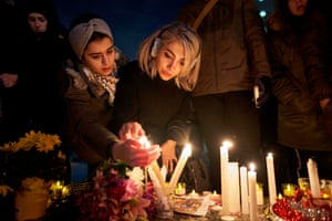 Mourners light candles for the victims of Ukrainian Airlines flight 752 during a vigil in Toronto.
