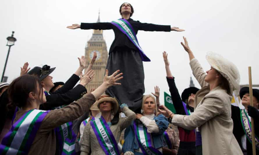 Activists dressed as suffragettes protest in Parliament Square, 2012.