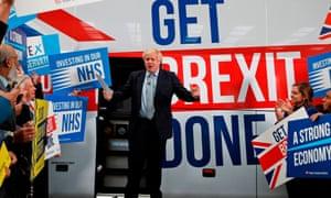 Boris Johnson steps from his battlebus.