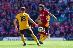 Salah controls the ball in the air.