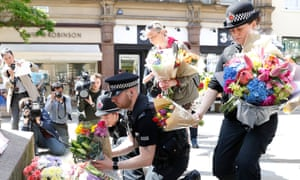 Flowers are left in St Ann's Square, Manchester, on Tuesday afternoon.