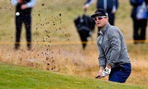 Zach Johnson plays out of a bunker on his way to a second-round score of 67 and a share of the overnight lead.