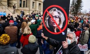 A man holds up a sign against Rep. Liz Cheney at a rally against her last week.