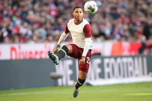 Serge Gnabry, in Bayern's replica of their first shirts 120 years ago, looks to control the ball